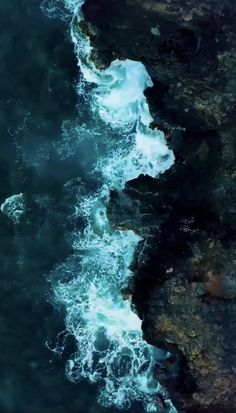 Water Hitting Rocks at Ocean Shore - Photography