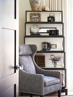 """""""Cameras are good for much more than preserving memories. Repurpose a collection of vintage cameras for use as an artful bookshelf display. The antique look of all accessories unites the items throughout this bookshelf to create a cohesive display that's filled with vintage character."""""""