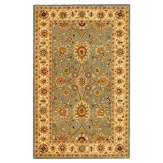 Hand-tufted wool rug with a light blue and ivory floral motif.   Product: RugConstruction Material: 100% Wool