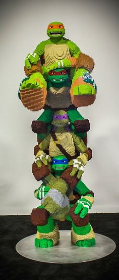 Check out this totally radical LEGO sculpture featuring all four of the Teenage Mutant Ninja Turtles. Built by some of LEGO's Master Builders, this awesome tower of mutant chelonians stands six feet,. Lego Design, Lego Sculptures, Amazing Lego Creations, Lego Worlds, Everything Is Awesome, Lego Brick, Teenage Mutant Ninja Turtles, Teenage Ninja, Legoland