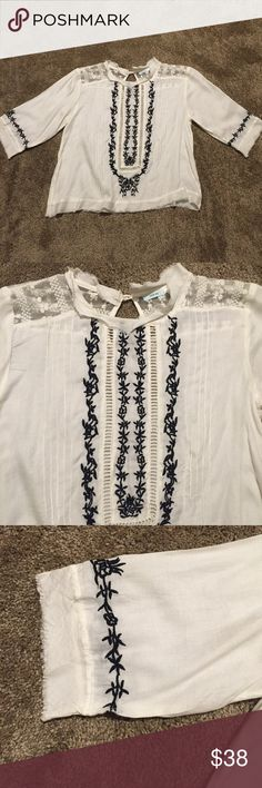 Urban outfitters embroidered crop top size M Urban outfitters embroidered crop top size M. Lightweight white crop top with pleats and black embroidery, unfinished hem and a pear button back closure. Worn once, perfect condition. No trades. Urban Outfitters Tops