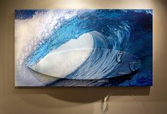 The beauty of water in motion, this photograph of a wave breaking on a remote Tahitian reef captures the subtle details of waterdrops dancing inside the tube. A unique combination of a photo-wrapped surfboard mounted in perfect registration to the print the board mounts on top of the print to produce a 3D art surfboard, a unique creation of the Aaron Chang Ocean Art Gallery. Call the gallery for more details: (858)345-1880 Custom Surfboards, Photo Wrap, Skate Decks, Surf Board, Ocean Art, Art World, Dancing, Remote, Surfing