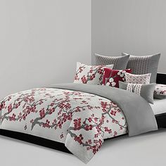 Bring the beauty of nature into your bedroom with the lovely N Natori Cherry Blossom Reversible Duvet Cover. Decked out in rich red cherry blossoms, a symbol of happiness, love and hope, the beautiful bedding is an exquisite addition to any room's décor.