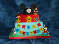Mickey Mouse 1st Birthay - French vanilla with strawberry filling.  The MM hat on top is rice cereal treats.  The figurines are plastic (don't mess with Disney), all other decorations fondant/gumpaste.  Inspiration came from the tons of Mickey cakes on CC.