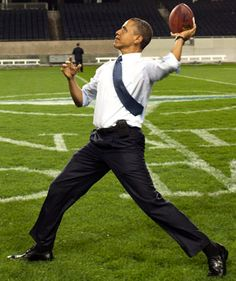 President Obama throwing the pigskin in Soldier field.