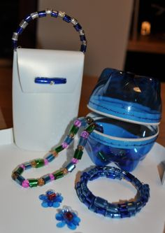 A purse made of a shapmpoo bottle and PET bottle jewelry