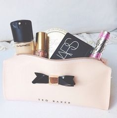 Ted Baker.. now this is a cute make up bag, filled with stuff I like!