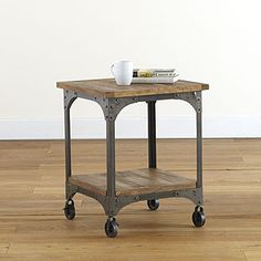 Aiden Furniture Collection has a stylish industrial design with its mango wood surfaces and metal frames with casters. The Aiden End Table gives your space a rustic feel that is both sensible and stylish and looks lovely when topped with a plant, books or picture frames.