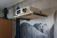 Post with 20 votes and 6491 views. Projector shelf from pine and plumbing pipe Projector Shelf, Projector In Bedroom, Projector Stand, Home Cinema Projector, Home Theater Projectors, Projector Screens, Movie Bedroom, Bedroom Setup, Theater Room Decor