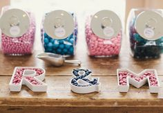 DIY Candy bar in your theme colors with the initials of the newlyweds