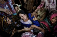 Women try to comfort a mother who lost her son in a bombing in Lahore, Pakistan.