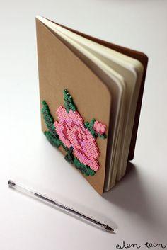eilen tein: Notebooks decorated with perler beads.