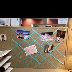 Cube collage. I pinned ribbon to the wall of my cubicle so I could have a decorative photo collage