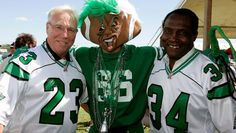 'Royalty' attached to George Reed's name in Riderville - GEORGE REED (RIGHT) AND THE LATE RON LANCASTER (LEFT) POSE WITH FANS IN REGINA (THE CANADIAN PRESS CFL.ca Saskatchewan Roughriders, Canadian Football, Football Stuff, Cool Items, Lancaster, Royalty, Fans, Poses, Running
