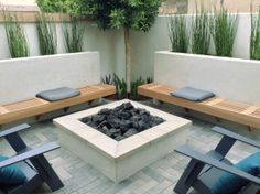 Look at how symmetrical this Costa Mesa fire pit area is!  Complete with custom benches. http://www.trulandscape.com