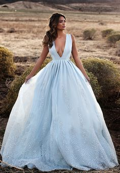 All brides dream of having the ideal wedding day, but for this they need the most perfect wedding gown, with the bridesmaid's dresses actually complimenting the brides dress. Here are a number of tips on wedding dresses. V Neck Prom Dresses, Blue Wedding Dresses, Blue Dresses, Wedding Gowns, Formal Dresses, Wedding Blue, Light Blue Wedding Dress, Wedding Beach, Bridal Gown