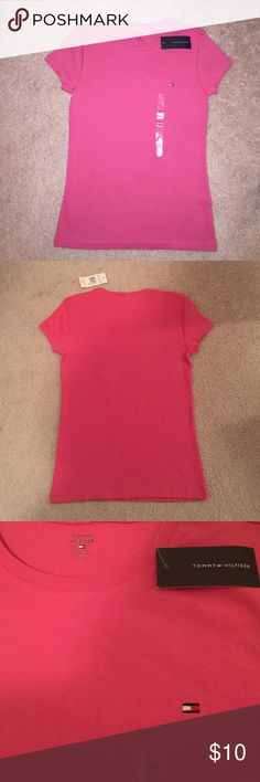 NWT Tommy Hilfiger scoop neck T-shirt Brand new with tag & size sticker still attached Tommy Hilfiger scoop neck t-shirt in a dark pink or coral color. Bought several colors of these t-shirts and only wore half. Selling the ones never worn. Shirt is perfect holiday gift as still has tag and size sticker still attached. True size medium. 100% cotton! Open to reasonable offers. Great new & unused shirt! Tommy Hilfiger Tops Tees - Short Sleeve