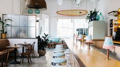 US design studio Basic Projects has gutted a restaurant in South Carolina and transformed the dark interior into an eclectic, light-filled dining space.
