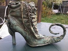 Fabulous shoe created by Ann Parker-Griffiths, using Powertex.