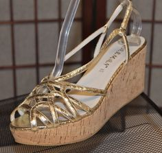 NEW Snake Embossed DELMAN Gold Leather Cork Wedge Platform Slingbacks Sandals 7Our price: $39.00http://2tymingthreads.com/index.php?l=519285