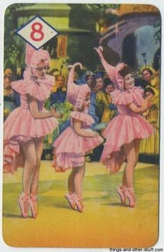 """They represent the Lullaby League and they wish to welcome Dorothy Gale to Munchkin Land. Artwork from the 1940 Castell Brothers card game for """"The Wizard of Oz."""""""