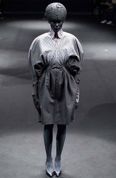 "ANREALAGE AW2015  Per Carl Jung, this collection is about"" to confront a person with their own shadow is to show them their own light""."