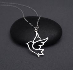 Simple but beautiful necklace featuring a sterling silver Dove pendant on a sterling silver chain. The pendant measures 1 1/8 high including
