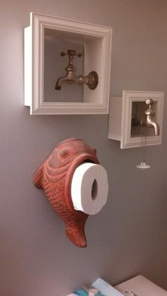 Ceramic fish planter turned TP holder. Vintage faucets mounted in shadow box frames. Bathroom Art.