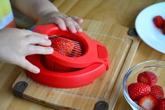 Montessori toddler activity (at 2 years) slicing a strawberry Need to find this slicer!!