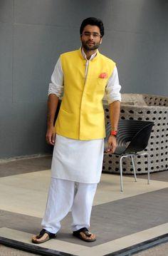 A sherwani kurta with dhoti looks dapper Mens Indian Wear, Mens Ethnic Wear, Indian Groom Wear, Indian Men Fashion, Indian Man, Mens Fashion, Nehru Jacket For Men, Nehru Jackets, Kurta Pajama Men