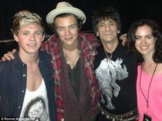 Rolling in One Direction! Harry Styles and Niall Horan posed with Ronnie Wood and his wife Sally Humphrys after the Rolling Stones gig in Washington DC on Monday night