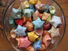 Origami stars with inspirational quotes inside, made with scrapbook paper.