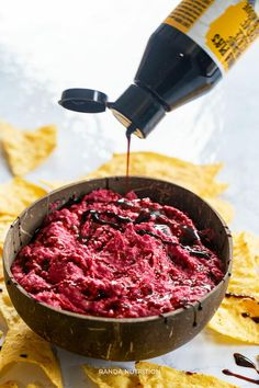 """This healthy balsamic beet hummus recipe is a vegan holiday appetizer perfect for party snacks or for dipping crackers while watching TV.  You are going to LOVE this recipe for beet hummus. I love the added """"oomph"""" the balsamic glaze gives and it goes with everything!  It's so easy to make because all you have to do is toss all the ingredients in a food processor and blend until smooth.  You can also use a high powered blender, but it may take a little longer."""