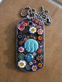 detail and patience:  mosaic dog tag pendant made with Italian lampwork millefiori.