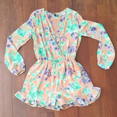 HP 5/17 Long sleeve floral romper NEVER WORN! Taupe long sleeve romper with deep v neck. Ruffles detail on shorts. Sheer up top so best to wear with bandeau! Dresses