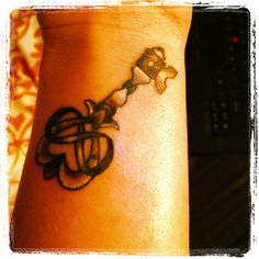 Key tattoo - heart and infinity symbol in the top.