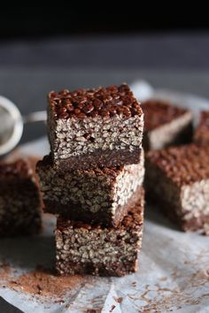 Chocolate Brownie Crackle Squares! A walnut coconut brownie base topped with a chocolate crackle layer, for a chewy crunchy texture. Vegan + gluten-free.