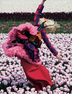 Model wears checked puffa jacket by Thakoon, blue printed shirt by Edun, orange shirt tied around waist by DKNY, pink pleated skirt by Galliano, pink tutu from Beyond Retro, red dress by Victoria Beckham