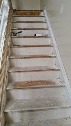 Particle board stair makeover- it can be done folks!
