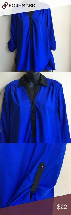 Blue & black tunic hi Lo top Brand new top missing tags . Blouse is missing brand . Fabric content,wash care , size labels .but it is a Sz Medium Tops Tunics
