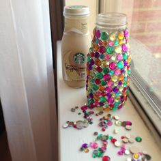 I added beads with my hot glue gun to my Starbucks Frappuccino glass bottles to sit outside on the patio with a long stem flower inside. Great way to reuse items