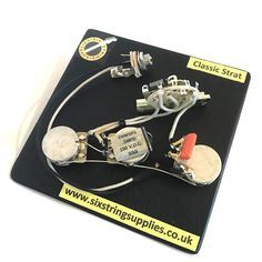 Featuring top components found in many high end guitars, this prewired Strat harness makes use of vintage style push back cloth wire which in conjunction with the components, contributes to help re...