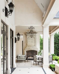 Here, a French, Neoclassical-Style residence in Dallas. The rear loggia's sofa and chairs by Murray's Iron Works are covered in fabric by Perennials and create a relaxing poolside retreat. See more: http://www.luxesource.com.