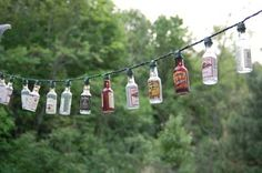 These instructions show you how to make cool patio party lights out of tiny booze bottles.