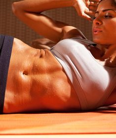 """The secret reason your tummy might not be getting firm isn't what you do in the gym, it's what you do the rest of the day. """"Something as simple as sitting at a desk all day can sabotage your ab"""