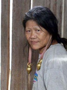 Malyasia ~ Borneo ~ Sarawak | Penan woman with her traditional elongated earlobes | ©Tajai, via flickr