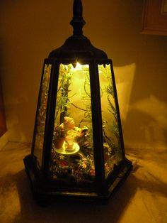 A miniature garden in a lamp shade http://www.guzziminiature.com/