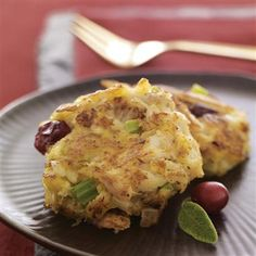 We made these miniature crab cakes to be served as holiday appetizers. Rubbed sage and orange zest season the crab cake mixture and dried cranberries add festive color. #recipe