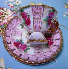 Teacup, saucer, & plate with a mother-of-pearl finish.