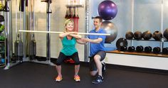 Personal trainer with exercising client